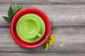 Empty plate and green cup — Stock Photo