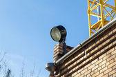 Military searchlight on brick wall — Stock Photo
