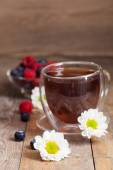 Herbal tea with chamomilies — Stock Photo