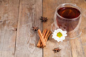Cup of tea with chamomile flower — Stock Photo