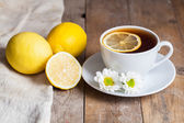 Herbal tea with chamomile and lemon — Stock Photo