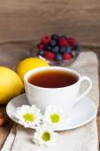 Herbal tea with chamomilies and lemon — Stock Photo