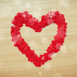 Love heart made with heart-shaped confetti — Stock Photo #62266895