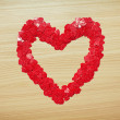 Love heart made with heart-shaped confetti — Stock Photo #62266937