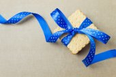 Cookies with blue ribbon — Stock Photo