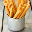 Tasty breadsticks grissini in  cup — Stock Photo #77852034