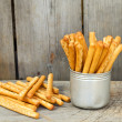 Tasty breadsticks grissini in  cup — Stock Photo #77852634