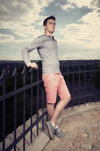 Young man posing in sundown — Stock Photo