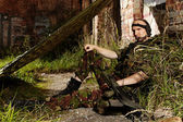 Soldier lives in field — Stock Photo