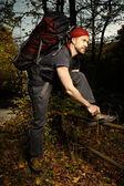 Man enjoys autumn sunny day on trek — Stock Photo
