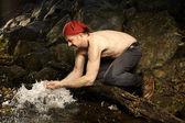 Morning routine in autumn creek — Stock Photo