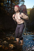 Divagating man with bag — Stock Photo