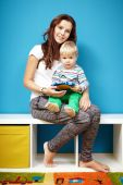 Mother with boy in room — Stock Photo