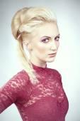 Nice girl in pink dress with blonde hair — Zdjęcie stockowe