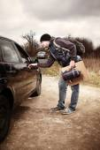 Hitch-hiker asking driver — Stock Photo