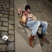 Man laying on street — Stock Photo