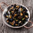 Boiled mussels in copper cooking dish — Stock Photo #52278775