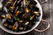 Boiled mussels in copper cooking dish — Stock Photo