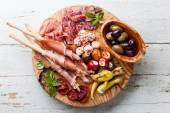Meat plate and grissini bread sticks — Stock Photo