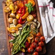 Grilled vegetables on cutting board — Stock Photo #54099495