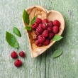 Raspberries with leaves — Stock Photo #54818867