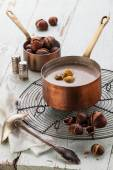 Chestnut soup in copper pot — Stock Photo