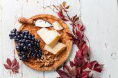 Parmesan cheese, grapes — Stock Photo