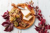 Parmesan cheese and grapes — Stock Photo