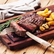 Sliced medium rare grilled Beef steak Ribeye with roasted potato — Stock Photo #58888527