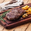 Medium rare grilled Beef steak Ribeye with roasted potato wedges — Stock Photo #58888541