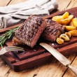 Sliced medium rare grilled Beef steak Ribeye with roasted potato — Stock Photo #58888551
