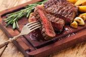 Sliced medium rare grilled Beef steak Ribeye with roasted potato — Stock Photo
