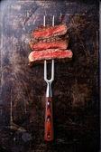 Beef steak on fork — Stock Photo