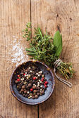 Peppers peas and spicy herbs — Stock Photo