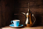 Coffee cup and Turkish Cezve — Stock Photo