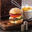 Burger with meat and French fries — Stock Photo #63479511