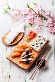 Sashimi and sushi rolls — Stock Photo