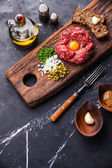Beef tartare with pickled cucumber — Stock Photo