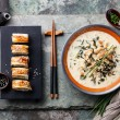 Creamy soup with Eel and sushi rolls — Stock Photo #66582819
