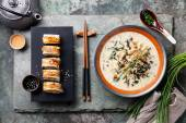 Creamy soup with Eel and sushi rolls — Stock Photo