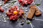 Beef tartare with fresh toasts — Stock Photo