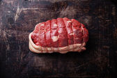 Rolled-up raw beef meat — Stock Photo