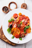 Tomatoes salad with olive oil and balsamic — Stock Photo