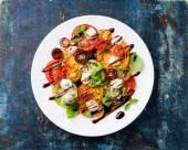 Tomatoes salad with mozarella and balsamic — Stock Photo