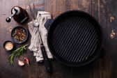 Grill pan, seasonings and meat fork — Stock Photo