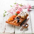 Постер, плакат: Sushi Set with sashimi and sushi rolls