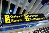 Airport terminal direction sign — Stock Photo