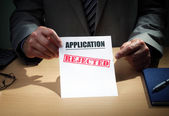 Businessman showing application has been rejected — Stock Photo