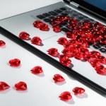 Heart shape symbols on laptop keyboard — Stock Photo #63468263