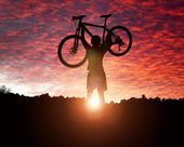 Mountain biking at sunset — Stock Photo